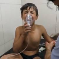 A Syrian boy breathes with an oxygen mask at a hospital in this image from a video taken Sept. 7, a day after a suspected chlorine gas attack in Aleppo. | REUTERS