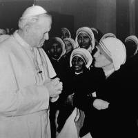 Pope John Paul II talks with Mother Teresa after he celebrated a Mass for her in his private chapel at the Vatican on Dec. 13, 1980. | AP