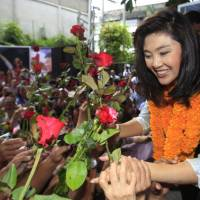 Ousted Thai leader Yingluck tells Prayuth to investigate his own brother over graft