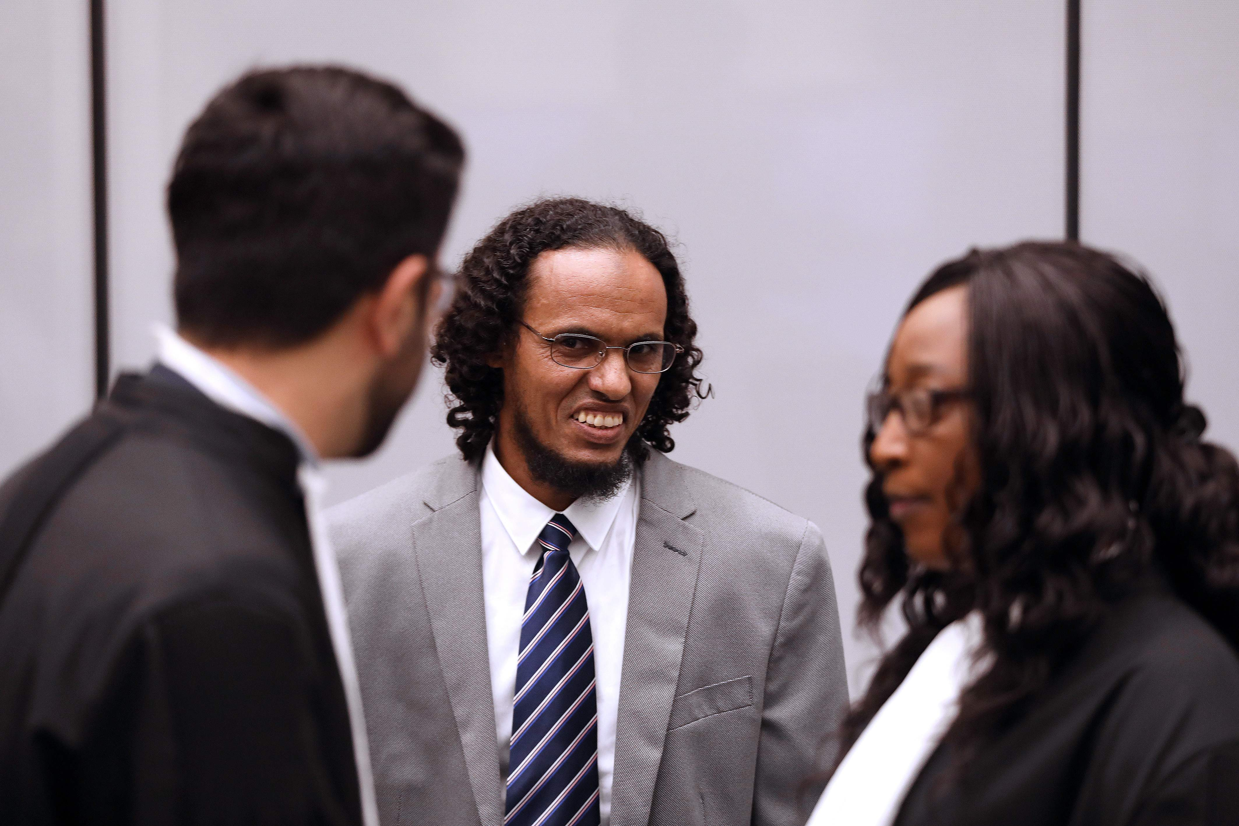 Malian jihadi Ahmad al-Faqi al-Mahdi reacts at the International Criminal Court (ICC) in The Hague on Tuesday during his sentencing for destroying Timbuktu's shrines. Mahdi was sentenced to nine years in jail for destroying the shrines, after he was found guilty of directing the 2012 attacks on the UNESCO world heritage site in northern Mali. | BAS CZERWINSKI / ANP / AFP-JIJI