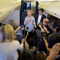 Clinton faces press, blasts Russia meddling in U.S. polls as Trump again softens on immigration