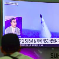 A man watches a television news showing file footage of a North Korean missile launch at Incheon airport, west of Seoul, on Wednesday. | AFP-JIJI