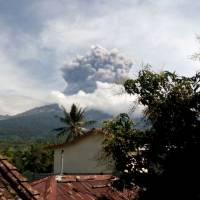 Erupting Mount Barujari is seen from Bayan, Lombok Island, Indonesia, Tuesday. The volcano erupted without warning on Tuesday afternoon, delaying flights from airports on the islands of Lombok and Bali. | AP