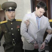 Otto Warmbier is escorted at North Korea's Supreme Court on March 16, when he was sentenced to 15 years in prison | AP