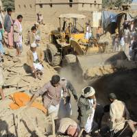 People search for victims under the rubble of houses destroyed by a Saudi-led airstrike in the northwestern city of Saada, Yemen, Wednesday. | REUTERS