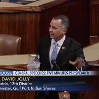 In this frame grab from video provided by C-SPAN, Rep. David Jolly holds a container of mosquitoes while speaking of the House floor on Capitol Hill in Washington, Wednesday. 'The politics of Zika are garbage right now,' the Florida lawmaker said in a short, angry speech condemning Congress for failing to pass legislation providing $1.1 billion to combat the mosquito-borne virus. | C-SPAN VIA AP