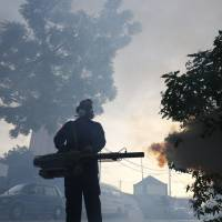 A worker from the Ministry of Health sprays mosquito insecticide fog Sept. 14 in Kuala Lumpur, a day after two new Zika virus infection cases were detected in the country. On Thursday, U.S. health officials were advising pregnant women to postpone travel to 11 countries in Southeast Asia because of Zika outbreaks in the region. | AP