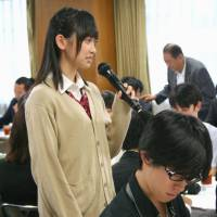 A high school girl offers her opinion at a meeting of the Liberal Democratic Party's special panel on the age of majority at LDP headquarters in August 2015. | KYODO