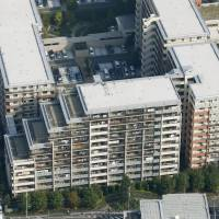 Residents of these four residential buildings in Yokohama agreed Monday to have the entire complex rebuilt. | KYODO