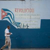 A Havana mural quotes Fidel Castro: 'Revolution is a sense of the historical moment; it changes everything that must be changed.' | ISTOCK