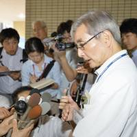 Yoichi Takahashi, who runs Oguchi Hospital in Yokohama, speaks to reporters on Tuesday. | KYODO