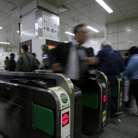 Japanese have for years been using rail passes that double as electronic money cards. | BLOOMBERG