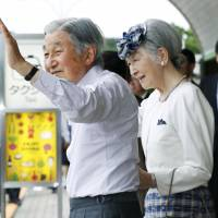 Emperor Akihito and Empress Michiko wave to the public during their recent visit to Yamagata Prefecture. | KYODO