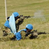 Self-Defense Forces troops take part in a multinational peacekeeping exercise in Tavan Tolgoi, Mongolia, on May 27. | KYODO