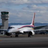 A Mitsubishi Regional Jet touches down at Nagoya Airport in Toyoyama, Aichi Prefecture, following its maiden flight last November. If it passes testing, it will become Japan's first domestically produced commercial plane since 1974. | BLOOMBERG