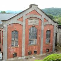 This historic building at Kansai Electric Power Co.'s Keage Power Station is no longer in use, but the plant remains active today. | KYODO