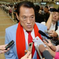 Lawmaker Antonio Inoki faces reporters in Beijing on Tuesday after returning from a visit to North Korea. | KYODO