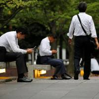 Japan's jobs-for-life system a reason for static wages