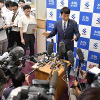 Gov. Satoshi Mitazono speaks to the media Friday at the Kagoshima Prefectural Government office in the city of Kagoshima. | KYODO