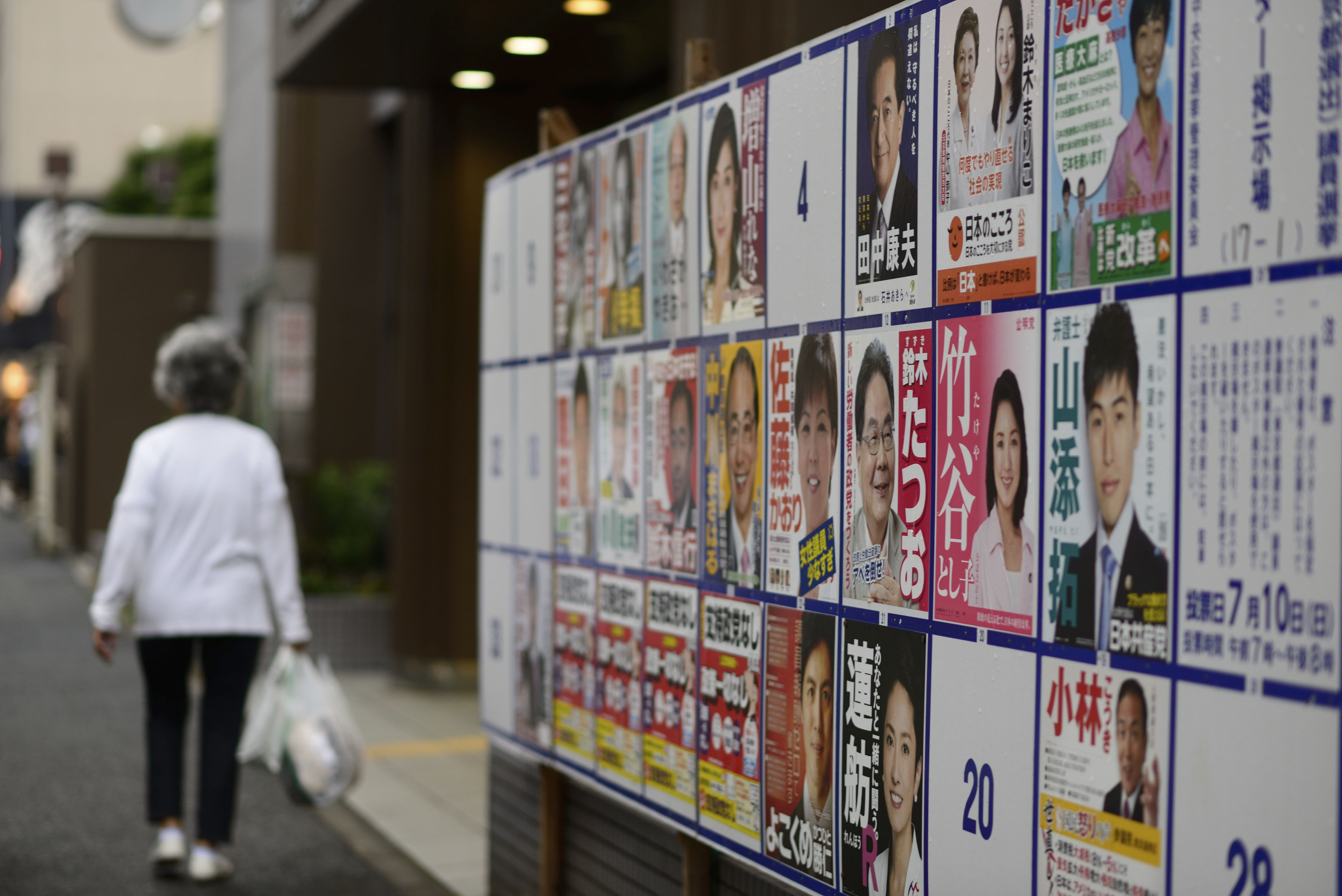 A woman walks past posters of candidates for July's Upper House election in Tokyo. | ISTOCK