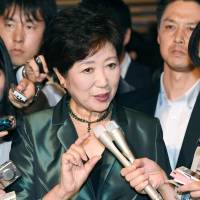 Tokyo Gov. Yuriko Koike speaks to reporters Friday at the Prime Minister's Office after a meeting of a key government panel on regulatory reform. | KYODO