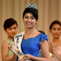Priyanka Yoshikawa smiles as she holds the trophy after winning the Miss Japan title during the Miss World Japan 2016 Beauty Pageant in Tokyo on Monday. The half-Indian 22-year-old model won the title to represent Japan in the Miss World 2016 contest. | AFP-JIJI