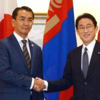 Foreign Minister Fumio Kishida (right) greets his visiting Mongolian counterpart, Tsend Munkh-Orgil, in Tokyo on Tuesday. | KYODO