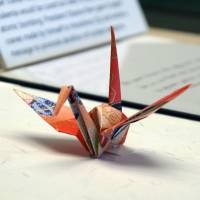 A paper crane folded by U.S. President Barack Obama in Hiroshima in May is displayed at the Nagasaki Atomic Bomb Museum . | KYODO