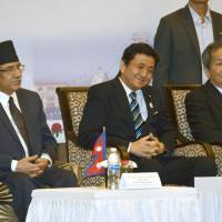 Senior Vice Foreign Minister Nobuo Kishi (center) attends a ceremony in the Nepalese capital of Kathmandu on Thursday to mark the 60th anniversary of the establishment of diplomatic ties between the two countries. | KYODO
