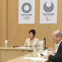 Japanese Olympic Committee President Tsunekazu Takeda (left) tells Tokyo Gov. Yuriko Koike (second from right) and Olympic minister Tamayo Marukawa about the results of investigations into dubious payments that Tokyo's bidding team allegedly made to a Singaporean consultancy. | KYODO