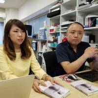 Lighthouse spokeswoman Aiki Segawa (left) and Arata Sakamoto, the group's secretary-general, speak about the memoir of Colombian woman Marcela Loaiza that hit stores last month at their office on Aug. 23 in Tokyo. | TOMOHIRO OSAKI