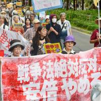 Protests held across Japan one year after security laws' passage