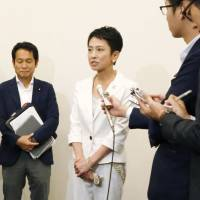 Democratic Party deputy head Renho talks about dual citizenship during a hastily arranged news conference in Tokyo on Tuesday. | KYODO