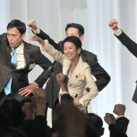 Newly elected Democratic Party leader Renho celebrates her victory following voting by DP lawmakers in Tokyo on Thursday. Party rank and file voted by mail earlier this week.   YOSHIAKI MIURA