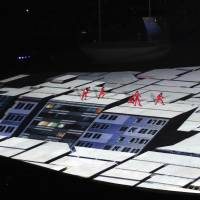 Performers jump on the rooftops of projected buildings during the opening ceremony of the Rio Olympic Games on Aug. 5 in Rio de Janeiro.   PANASONIC CORP. / VIA KYODO