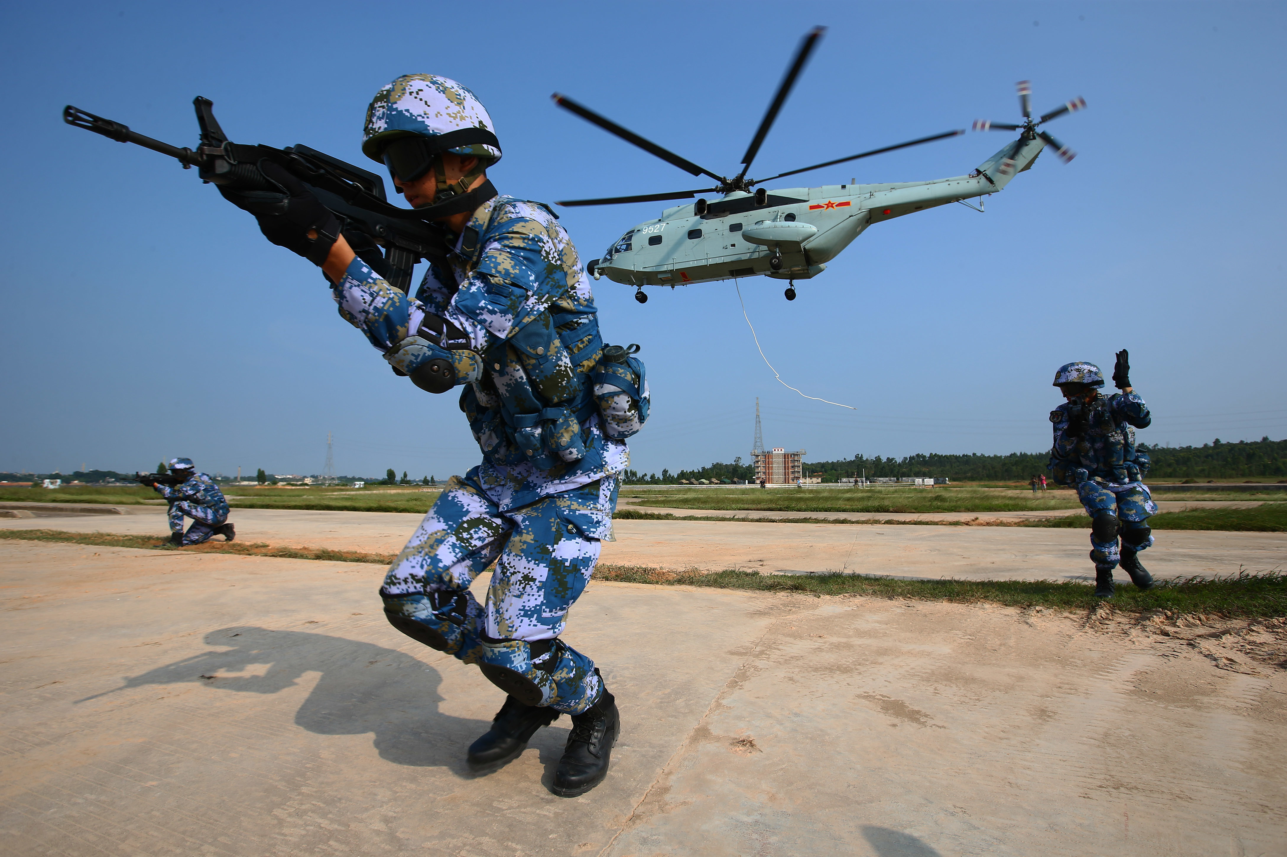 Chinese marines take part in a joint naval drill with Russian forces in Zhanjiang, south China's Guangdong Province, on Sept. 13. | XINHUA NEWS AGENCY / VIA AP