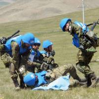 Self-Defense Forces troops take part in the multinational peacekeeping exercise Khaan Quest in Tavan Tolgoi, Mongolia, on May 27. | KYODO