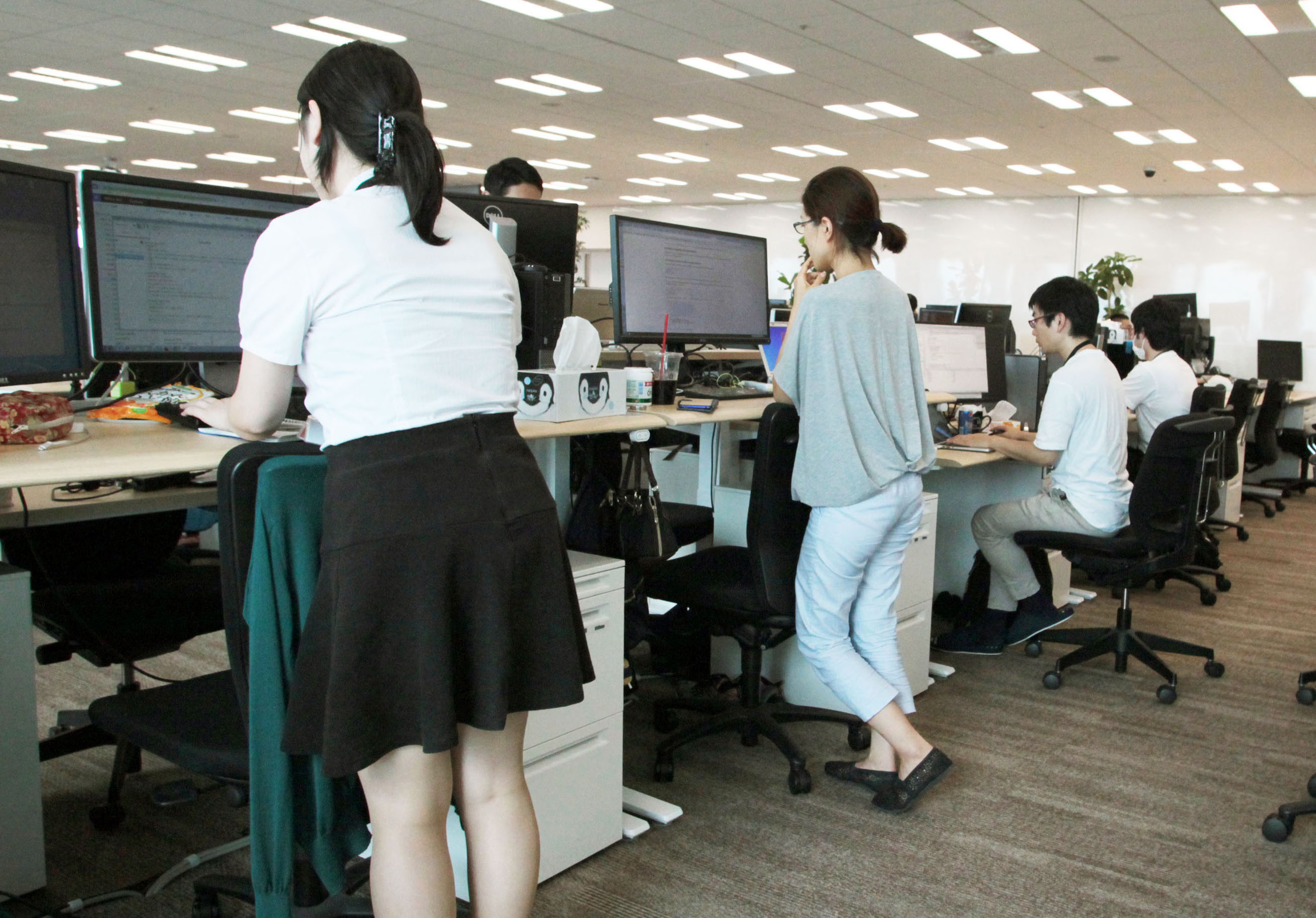 Workers stretch their legs at Rakuten Inc.'s head office in Tokyo's Setagaya Ward. | KYODO