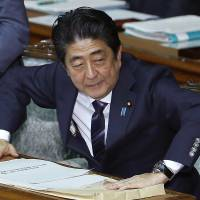 Prime Minister Shinzo Abe prepares to speak in the Lower House of the Diet on Monday. | AP