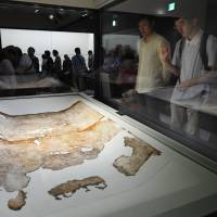 Visitors look at a celestial map from the ancient Kitora tomb, which dates from the seventh to eighth centuries, at a museum in Asuka, Nara Prefecture, on Saturday. | KYODO