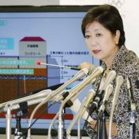Tokyo Gov. Yuriko Koike tells reporters at a news conference Saturday in Tokyo that clean soil was not placed under three main structures of the planned Toyosu food wholesale market in Koto Ward, where the famed Tsukiji fish market is to be relocated. | KYODO