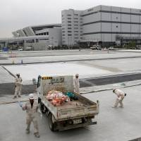 Workers are seen at the new Tokyo Metropolitan Central Wholesale Market on Sept. 27, known as Toyosu market, which will take over from the famous Tsukiji market. | REUTERS