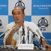 Junichi Ito, head of the Tsukiji fish market wholesalers cooperative, speaks at a news conference Wednesday in Tokyo. | MAGDALENA OSUMI