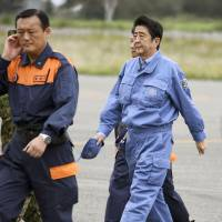 Prime Minister Shinzo Abe arrives at a Ground Self-Defense Force camp in Obihiro, Hokkaido, on Wednesday after taking a helicopter tour over the city to examine the damage caused by torrential rains brought by Typhoon Lionrock in late August. | KYODO