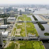 An aerial photo shows a site in Tokyo's Koto Ward where Ariake Arena, a venue to be used for volleyball games in the 2020 Tokyo Olympics, is planned to be constructed. | KYODO