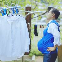 Yamaguchi Gov. Tsugumasa Muraoka wears a so-called pregnancy vest in this screen shot from the video 'The Governor is a Pregnant Woman.' | REUTERS