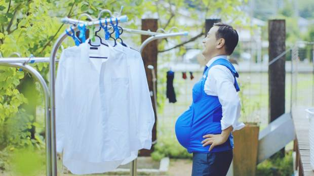 Japan governors wear 'pregnancy' vests to urge men to help at home