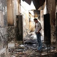 Hospitals as targets: An employee of Medecins Sans Frontieres walks inside the charred remains of the organization's hospital in Kunduz, Afghanistan, weeks after the building was hit by a U.S. airstrike on Oct. 3, 2015, killing 42 people.   AP