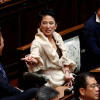 Meet the new boss: Renho, the new leader of the main opposition Democratic Party, talks with Upper House lawmakers before the start of the new Diet session on Monday.   REUTERS