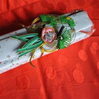 Signed, sealed, delivered: A gift received by the author's neighbor's daughter from the doctor who adopted her. Traditionally on this Seto Inland Sea island, such packages contain a fan (for girls) or a pair of chopsticks (for boys). | AMY CHAVEZ
